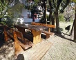Outside wooden benches and chairs - Apartments Ana Lopar