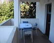 A beautiful terrace with table - Apartments Ana Lopar